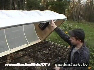 The cold frame hoop house fits just inside the raised bed. nice.