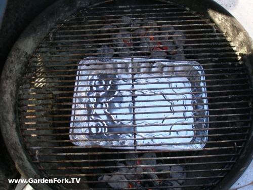 add a drip pan between the coals