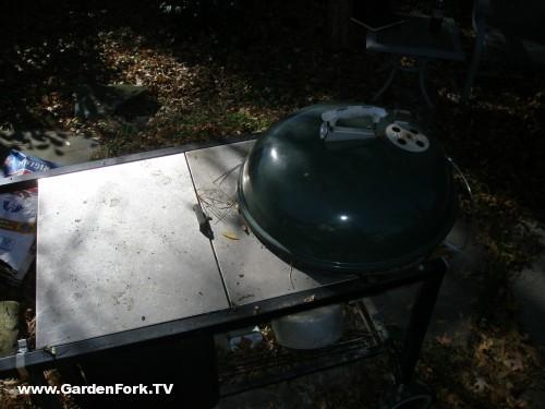 charcoal burning grill, propane lit