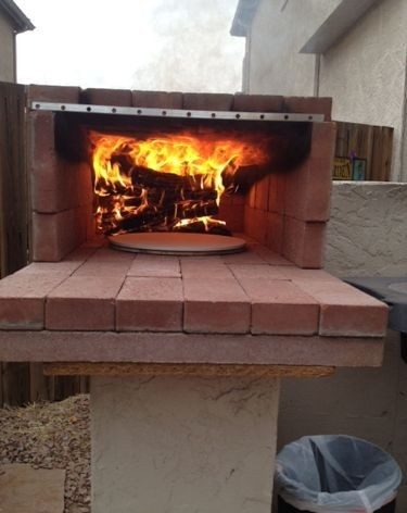 brick pizza oven with pizza baking in it