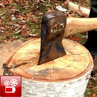 split wood with an axe