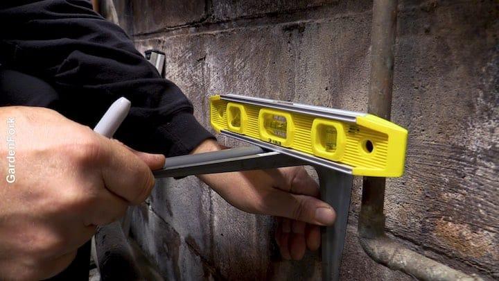 using a level installing shelf bracket