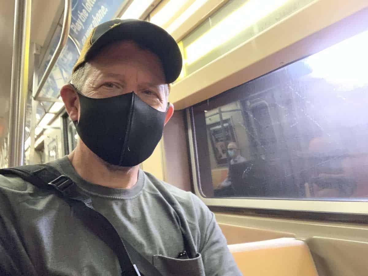 man on subway train